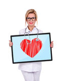 Big digital tablet with heart Royalty Free Stock Images