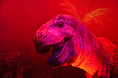 Big dinosaur - close up on red background Stock Photos