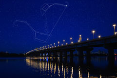 Big Dipper and Little Dipper. The Big Dipper Plough and the Little Dipper constellations seen over Dnieper River at a starry night. Polaris is the brightest star stock image