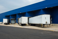 Big distribution warehouse with gates for loads and trucks. Transportation service delivery station. Big distribution warehouse with gates for loads and trucks stock images