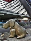 Big dog. Big stone dog sitting at Amsterdam Central Royalty Free Stock Photo