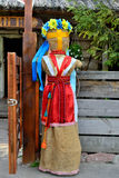 Big doll. In Ukrainian national style at the entrance to the restaurant Royalty Free Stock Photo