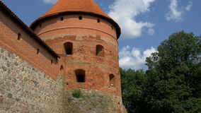 The big dome tower of the old castle in Trakai GH4 4K UHD. The big dome tower of the old castle in Trakai Lithuania red brick stone wall is visible from outside stock video