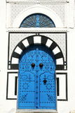 Big door. An old door in the artist village, Sidi Bou Said in Tunisia royalty free stock photography