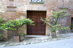 Big Door in Montepulciano. Brown Door in Montepulciano village Stock Images