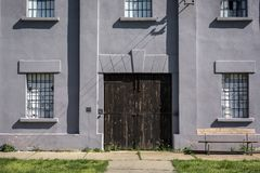 Big door on old building in concentration camp stock image