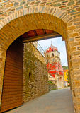 The big door. Old red belfry  framed by a door in Iviron monastery in holy mountain Athos in Greece Stock Image