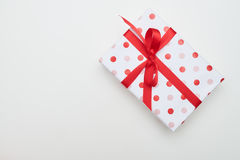 Big dotted gift box with red ribbon and bow tie Stock Photos