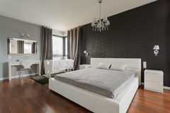 Big double bed. Big comfortable double bed in elegant classic bedroom royalty free stock image