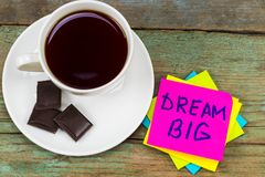 Big dream - inspirational handwriting in a pink sticky note with. A cup of coffee and chocolate stock photos