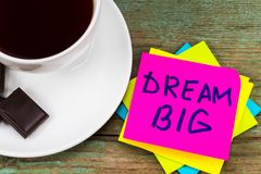 Big dream - inspirational handwriting in a pink sticky note with. A cup of coffee and chocolate stock images