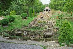 Big dry stone fountain and chapel on top of hill.  Stock Photos
