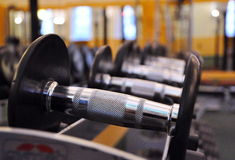 Big dumbbells lying in a row Royalty Free Stock Photo