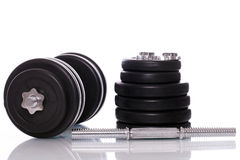 Big dumbells over white background Stock Photos