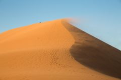Big dune and tourists Royalty Free Stock Images