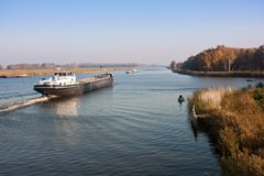 Big Dutch canal and a cargo vessel Royalty Free Stock Photography