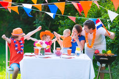 Big dutch family having grill party in garden Stock Image