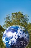 Earth day concept planet ball in outdoor park Royalty Free Stock Photos