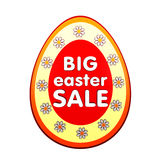 Big easter sale in red egg shape label with flowers. Big easter sale banner - 3d red egg shape label with white text and flowers, business concept Royalty Free Stock Image