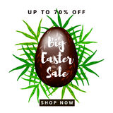 Big Easter Sale. Colorful background with brown, chocolate egg and green leaves Stock Photo