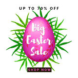 Big Easter Sale. Colorful background with pink egg and green leaves Royalty Free Stock Photo