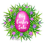 Big Easter Sale colorful background with pink egg, green leaves Stock Photography