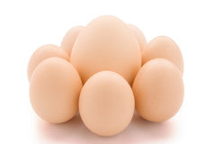 Big egg surrounded by small eggs Royalty Free Stock Image