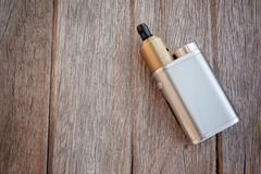 Big Electric cigarette on Wood Royalty Free Stock Photos