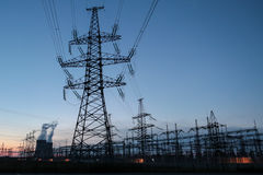 Big electrical substation. Sun setting over an electrical substation blue silhouettes Stock Photo