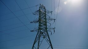 Big electricity pole. In the sunshine with clear blue sky stock video footage