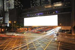 Big Empty Billboard. At night in city with busy traffic royalty free stock image