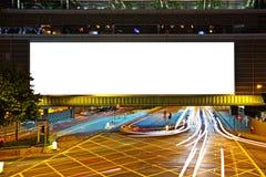 Big empty billboard at night. In city stock image