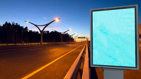Big empty billboard. On night highway stock photography