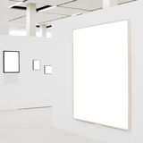 Big empty frame on white wall exhibition. And some small stock photography