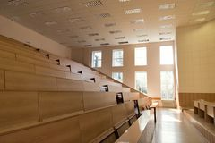 Big empty lecture hall. With bright shine from windows Stock Photography