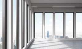 Big empty office with panoramic windows. Big empty office with windows and beautiful view of city. 3D render Stock Photos