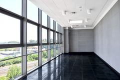Big empty office space with window wall. Day light illumination. royalty free stock photos