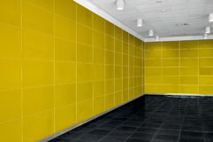 Big empty room interior with bright yellow wall, whire ceiling a stock photo