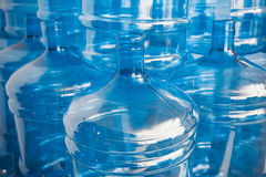 Big empty water bottles. Big empty blue water bottles at warehouse Stock Images