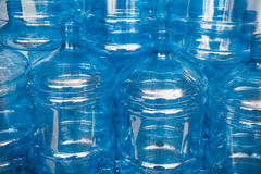 Big empty water bottles. Big empty blue water bottles at warehouse Royalty Free Stock Images
