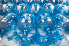Big empty water bottles. Big empty blue water bottles at warehouse Stock Image