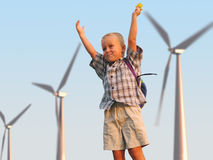 Big energy. Child and wind turbine Royalty Free Stock Images