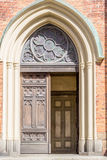 Big entrance door into a chuch. (Vertical View Stock Photography