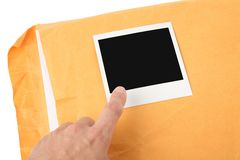 Big envelope and photo Stock Photography