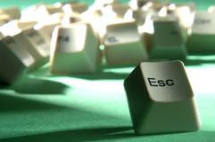 The big escape. Esc key escaping from crowd of keyboard keys Royalty Free Stock Photo
