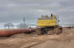 Big excavator. A Big Excavator at the Beach stock image