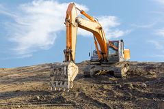 Big excavator on construction site Royalty Free Stock Images