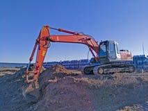 Big excavator digging a pit royalty free stock image