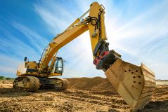 Big excavator in front of the blue sky stock images