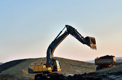 Big excavator load the truck Stock Images